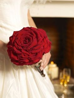 This style of bouquet is also known as glamelia or composite rose bouquet, they were very popular in the 40s and 50s. The bouquet is essentially one large flower assembled from the petals of around 20 roses. It is a labour intensive method and is definitely a task for a skilled florist. Hundreds of petals are painstakingly attached one by one.