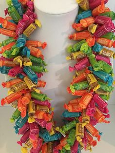 Made with Tootsie Fruit Chews Candy. Homemade Gifts, Diy Gifts, Quick Halloween Crafts, Graduation Leis, Graduation Crafts, Candy Bouquet Diy, Lego Custom Minifigures, Fruit Chews, Dance Gifts