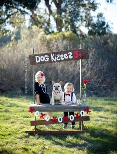A kissing booth photo shoot is a cute idea for Valentine's Day.