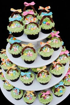 Wow, I am thinking a less complicated version for this amateur... but jelly beans for eggs on a spring cupcake - so cute!