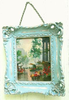 Morphing Frames ala Chalk Paint  With Annie Sloan Chalk Paint colors Provence, Duck Egg Blue, and Cream. Waxed and heavily distressed. And finally, backed with vintage wallpaper and classic Rolo chain for hanging. Now this little ol' resin frame can age with some dignity.