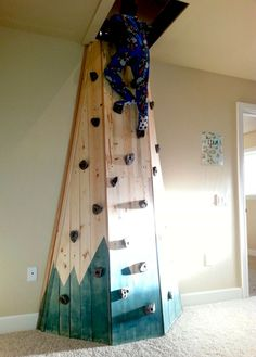 Secret Playroom: Indoor rock climbing wall in child's room that leads to a fort! Built-out attic space, converted to play room. Architectural Landscape Design