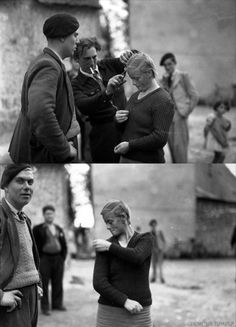 Members of the French Resistance shaving off the hair of  a collaborationist woman.