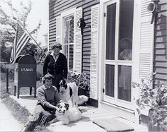 Citation: Chenoweth Hall (standing) and Miriam Colwell (seated) in front of post office in Prospect Harbor, Maine, with their dogs Lassie and Stormy, ca. 1960 / unidentified photographer. Chenoweth Hall papers, Archives of American Art, Smithsonian Institution.