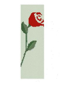Red rose peyote pattern, this floral pattern features a red rose with red and green seed beads,  the peyote cuff are (2in x 6.57in)