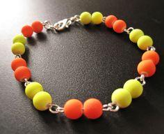 Bracelet rave party orange fluorescent de la boutique TheAsaliahShop sur Etsy
