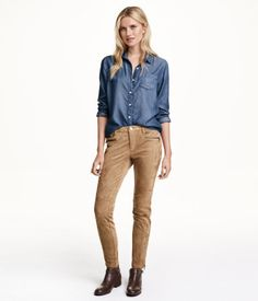 Pants in imitation suede with a regular waist. Side pockets, mock pockets at front with zip, and back pockets. Slim legs with decorative seams at front and at knees. Zips at hems.