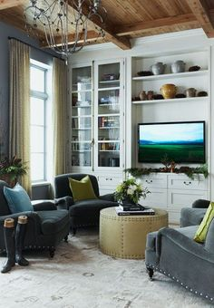 Wall Unit.  Chairs.  Ottoman.  Ceiling light.
