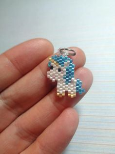 Lovely blue unicorn Handmade charm in brickstitch by using high quality miyuki bead delicas in different colours Double ring, clasp, keyring ore necklace are nickelfree the unicorn is 2 cm x cm In the last picture you can see the examples of the different Seed Bead Patterns, Beaded Jewelry Patterns, Bracelet Patterns, Beading Patterns, Pearl Stud Earrings, Beaded Earrings, Brick Stitch Earrings, Bead Loom Bracelets, Beaded Animals