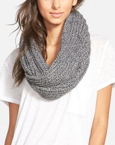 Completing the look with a cozy ribbed infinity scarf to stay effortlessly warm and stylish on the cold days.