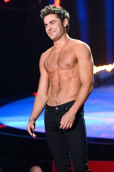 That smirk. Those abs. Zac Efron has done a nice job growing up!
