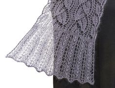 http://www.ravelry.com/patterns/library/claire---enchanting-lace-shawl