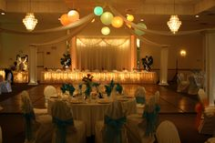 White lanterns with green, gold, peach, blue, and yellow lights in a dance canopy at Maneeley's Ballroom in South Windsor, CT.