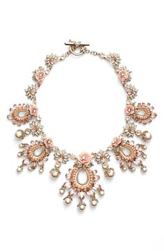 Free shipping and returns on Marchesa 'Drama' Floral Crystal Collar Necklace at Nordstrom.com. Lustrous faux pearl drops, faceted crystals, intricate metalwork and rosy-hued blossoms: this delightfully feminine piece has all the hallmarks of an outfit-making statement necklace.