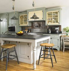 I like this combo.....white cabinet island/blue-grey wall cabinets combo kitchen (note restaurant quality stove with pot filler faucet too - ooh, ah)