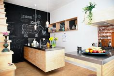 This renovated 19th century townhouse in the east of Amsterdam, sleeping up to 10 plus 2 young children and a baby, has a striking blackboard wall in the kitchen, a play set in the back yard and plenty to amuse parents and children alike