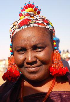 Songhai Woman with beaded headdress at Festival Tamadacht, Anderamboukane, Mali. | © Chris Greenwood
