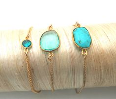 "Gemstones in shades of the sea, edged in 24k gold plate over solid sterling silver with lobster clasp. Sizes: petite- 6.5"" small- 7"" medium- 7.5"" large- 8"" Stone Choice: Turquoise Sea Green Quartz Blu"