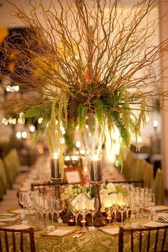 Curly willow branches give off a rustic vibe.Designed by David Tutera/Photo Credit: Mel Barlow