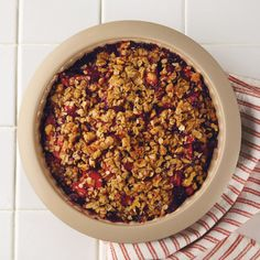 Fill your home this fall with the wonderful aromas of sweet apples and tart raspberries by making Raspberry Apple Crisp.