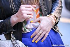 Yellow nails + leather jacket