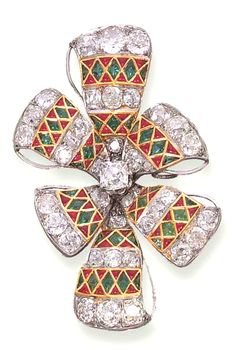 AN ANTIQUE DIAMOND, RUBY AND EMERALD BROOCH  Designed as a stylised bow set with old mine-cut diamonds, to the calibré-cut ruby and emerald detail, circa 1890
