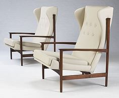 """Angular Teak Frame with new leather upholstery. Disk label under seat of each: """"Made and finished in Denmark Imported by Selig"""" The unused frames were discovered in a warehouse, and are now being given a fresh chance in life with new upholstery."""