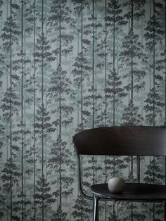 Beautiful and delicate, Engblad Pine wallpaper was inspired by the beauty of stately Scandinavian firs. The forest silhouettes make the most striking of backdrops for chic and simple living spaces. Grey Tone Wallpaper, Unique Wallpaper, Wallpaper Samples, Wallpaper Online, Pattern Wallpaper, Marimekko Wallpaper, Application Pattern, Forest Silhouette, Simple Living Room