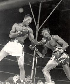 Sugar Ray Robinson lands an uppercut on Kid Gavilan (1948)