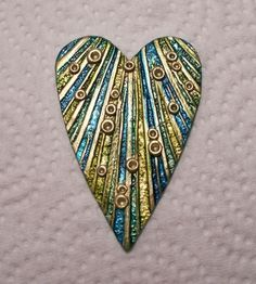 Polymer clay heart pendant focal bead metallic green teal blue gold texture by Sweet2Spicy, via Flickr