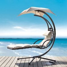"""The aptly titled """"Dream Chair Lounger"""" is most certainly that. SkyMall boasts that the $400 outdoor chair is """"contoured to match the ergonomics of your body"""" -- whatever that means. It just looks awesome and comfortable to us."""