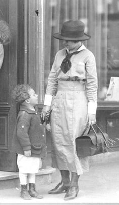 VNSNY nurse with child in the Lower East . The little black bag was a visiting nurses' badge.  When she was seen carrying that black bag she was given respect in whatever neighborhood she practiced.  I appreciated that badge of honor and safety that still existed in 1977, when doing my Senior nursing  community health rotation in  Rochester, NY.
