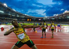 sportingnewsarchive:  Jamaica's Usain Bolt celebrates after anchoring the Jamaican team to the gold medal in the Men's 4x100m relay at Hampden Park Stadium during the Commonwealth Games 2014 in Glasgow, Scotland, Saturday Aug. 2, 2014. (AP Photo/Frank Augstein) Best photos of the week