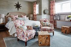 Sarah Richardson designed red guest bedroom with patterned chairs