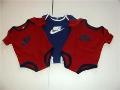 You are bidding on THREE (3) Nike onesies/bodysuits  for your baby boy    BRAND NEW  Size: 3-6 months  Color: Red (2) and Navy Blue(1)     NEW out of package