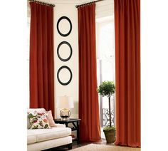 Orange curtains from Pottery Barn, very cheerful.
