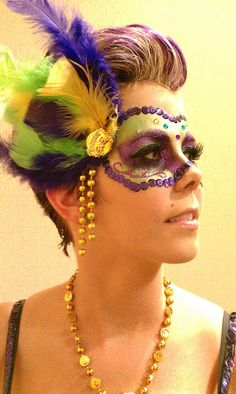 Mardi Gras mask inspired makeup. hand made from feathers mardi gras beads and sequins.