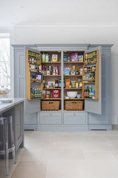 We've recently been spending a lot of time talking about inspirational pantries. These pantries are so nice, many of us can't imagine having anything that even comes close to comparison. They're walk-in storage closets that are usually bigger than our bedrooms! We'll never not lust over those pantries, but we're also totally crushing on this double larder cupboard. It's essentially a giant built-in cabinet dedicated just to food stuffs (and, by the way, it's still totally out of our reach)…