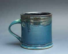Handcrafted pottery coffee mug, ceramic teacup, stoneware. Glazed inside with a glossy, easy to clean black glaze and outside with glossy, navy blue glaze with a slight green cast. More Blue Parrot cups and mugs: http://www.etsy.com/shop/BlueParrotPots?section_id=6797001 Approx. 4.75x 3. (opening) Will hold approx. 14 ounces of your favorite beverage. Food, dishwasher, and microwave safe, as is all of my work.