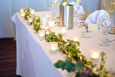 Ivy and fairy lights with frosted tea lights www.weddingflowersincornwall.co.uk