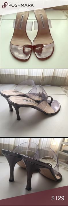 Manolo Blahnik mules 💯 Authentic Manolos in pewter and clear colors.  Worn a few times and show some wear on the back of heel such as scratches. Minor colt fading where the toe fits but this can't be seen while wearing them. Fits true to size 35.5 /5 or 5.5. No box or dustbag. Offers welcome. Manolo Blahnik Shoes