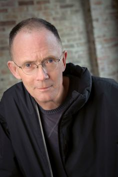 """William Gibson, is an American-Canadian speculative fiction novelist who has been called the """"noir prophet"""" of the cyberpunk subgenre. He coined the term """"cyberspace"""" in his short story """"Burning Chrome"""" and later popularized the concept in his debut novel, Neuromancer. In envisaging cyberspace, Gibson created an iconography for the information age before the ubiquity of the Internet in the 1990s. He is also credited with predicting the rise of reality television."""