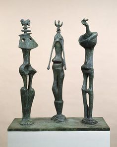 Henry Moore Three Standing Figures, 1953. Bronze and patina, 28 3/16 inches (71.7 cm) high.