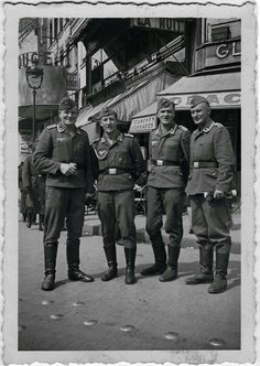 "German soldiers. Picture shoot near ""The Moulin Rouge"". Paris. Occupied France 1940."