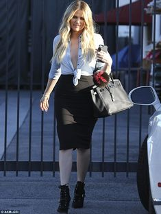 Sisterly love: Also seen on the day of filming was Kim's younger sister Khloe who was out and about in Los Angeles