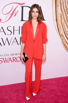 Emily Weiss in a plunging red suit and white pumps at the 2016 CFDA Awards