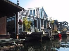 "The houseboats on Lake Union take ""lake house"" to a whole new, very literal, level. I love the charm of this one's shingles...and its huge windows."