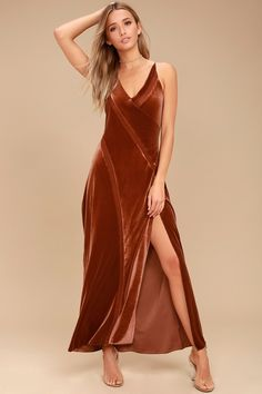 The Free People Spliced Rust Orange Velvet Maxi Dress is the piece you've been craving! Stunning stretch velvet maxi dress with sexy mesh inserts.