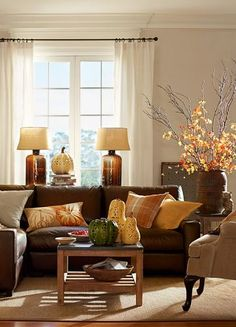 Harvest Hues // Pottery Barn- leaves from the yard, a few pillows in autumn colors, gourds and pumpkins from your garden or the market= no to low cost fall decor