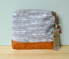 Mini Feather Zip Pouch - no instructions. Just inspiration. Maybe with a skinny long strap?